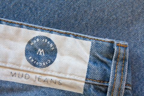 Circular jeans from MUD Jeans with printed waistband label.
