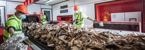 Wood waste being picked for recycling