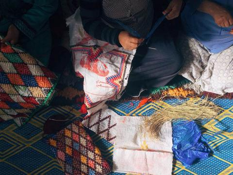Moroccan women producing durable by reusing other single-use bags