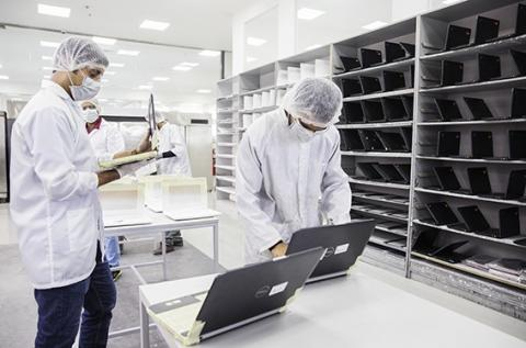 Engineers inspecting quality @ Circular Computings laptop remanufacting facility